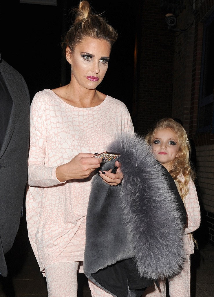 Katie Price and her young daughter Princess Tiaamii leave the New Victoria Theatre in matching tracksuits, having performed in the pantomime 'Sleeping Beauty'. Princess wearing a full face of makeup, despite the online backlash from people on social media, from when Katie put pictures of her daughter up on instagram the previous day Pictured: Katie Price, Princess Tiaamii Ref: SPL1195951 141215 Picture by: Squirrel / Splash News Splash News and Pictures Los Angeles: 310-821-2666 New York: 212-619-2666 London: 870-934-2666 photodesk@splashnews.com