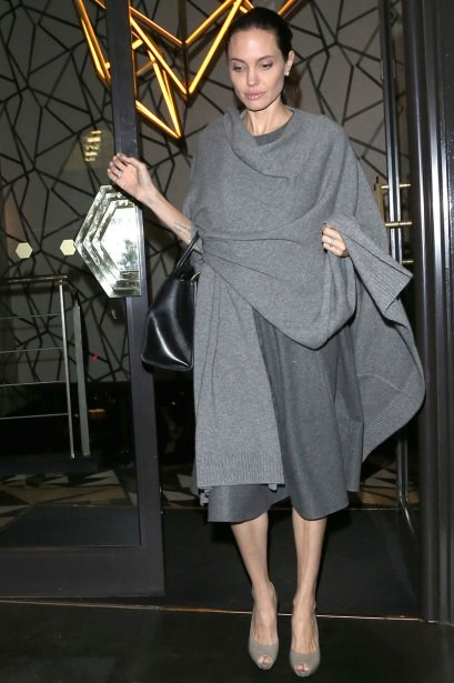 ** RESTRICTIONS: ONLY UNITED STATES, BRAZIL, CANADA ** London, UK - London, UK - Angelina Jolie goes out to dinner in an all grey outfit while meeting up with a friend at Quaglino's Restaurant. Angelina wore a dark gray knee length dress which she covered in a lighter grey shawl, which she matched with even lighter heels. AKM-GSI 25 APRIL 2016 To License These Photos, Please Contact : Maria Buda (917) 242-1505 mbuda@akmgsi.com or Steve Ginsburg (310) 505-8447 (323) 423-9397 steve@akmgsi.com sales@akmgsi.com