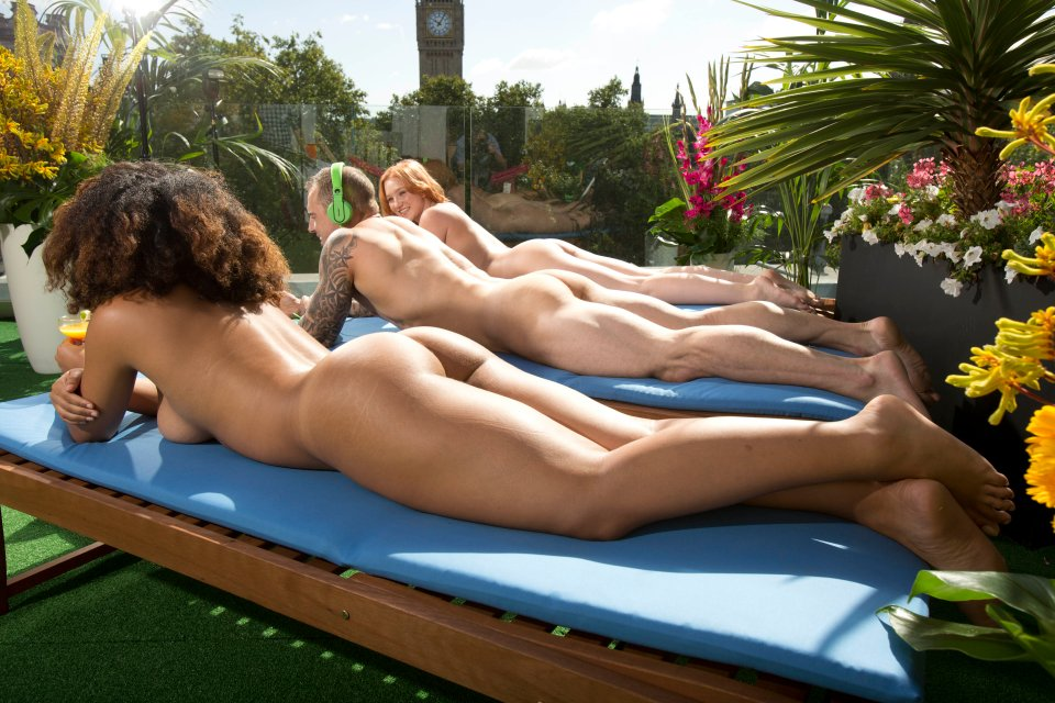 ** EDITORIAL USE ONLY** London¿s first nudist roof terrace is hoping to get bums on seats following its opening this week. See SWNS story SWNUDE. Guests won¿t need to dress to impress as they are encouraged to bare all and enjoy views of Big Ben and other London landmarks. Erected in Parliament Square, the new 'pop up' venue includes an open-air bar, sun-bathing areas and the opportunity for a bounce on its trampoline or a round or two of swing-ball. With Tuesday's opening coming ahead of the forthcoming heatwave, organisers are hoping the sun terrace doesn¿t get too steamy.